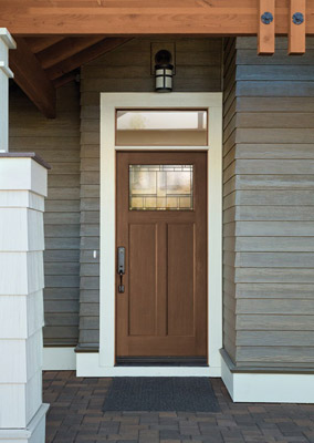 Brown fibreglass front door with small rectangular transom and quarter glass insert