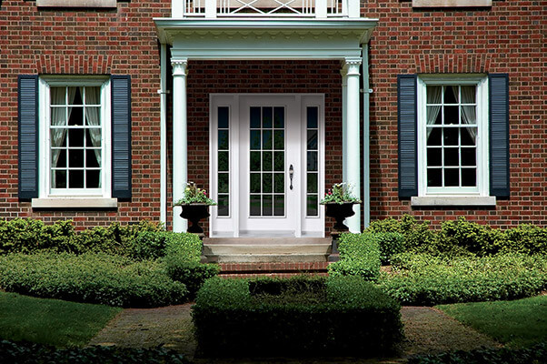 Colonial style front door with double sidelites