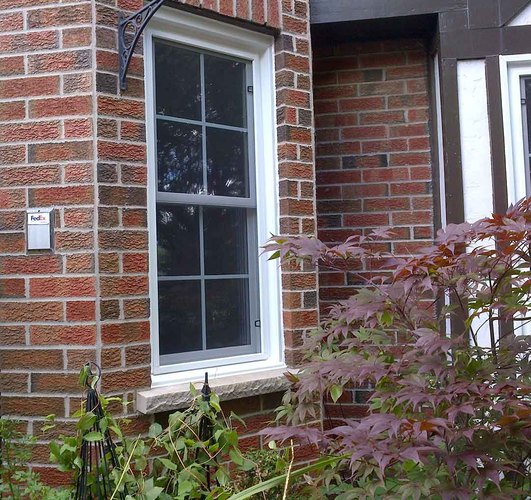 An exterior of a home with a double hung window installed.