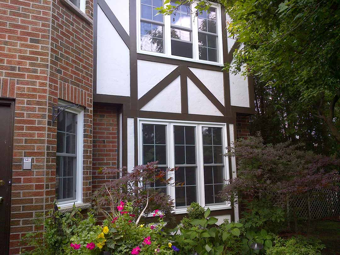 An exterior of a home with three double hung windows.