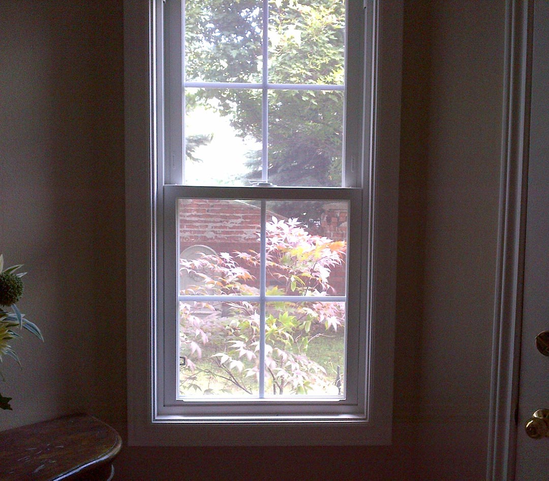 An interior of a home with a double hung window installed.
