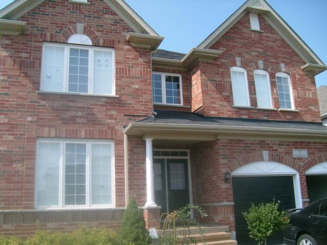 The front face of a house with casement and fixed windows installed.