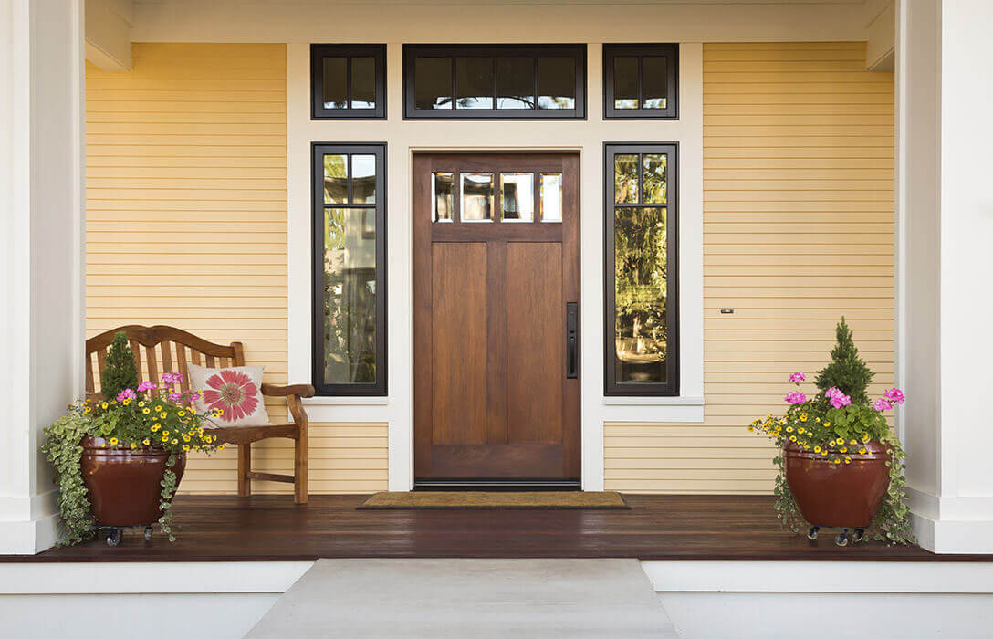 Modern front door with three-quarter sidelites and custom transom.