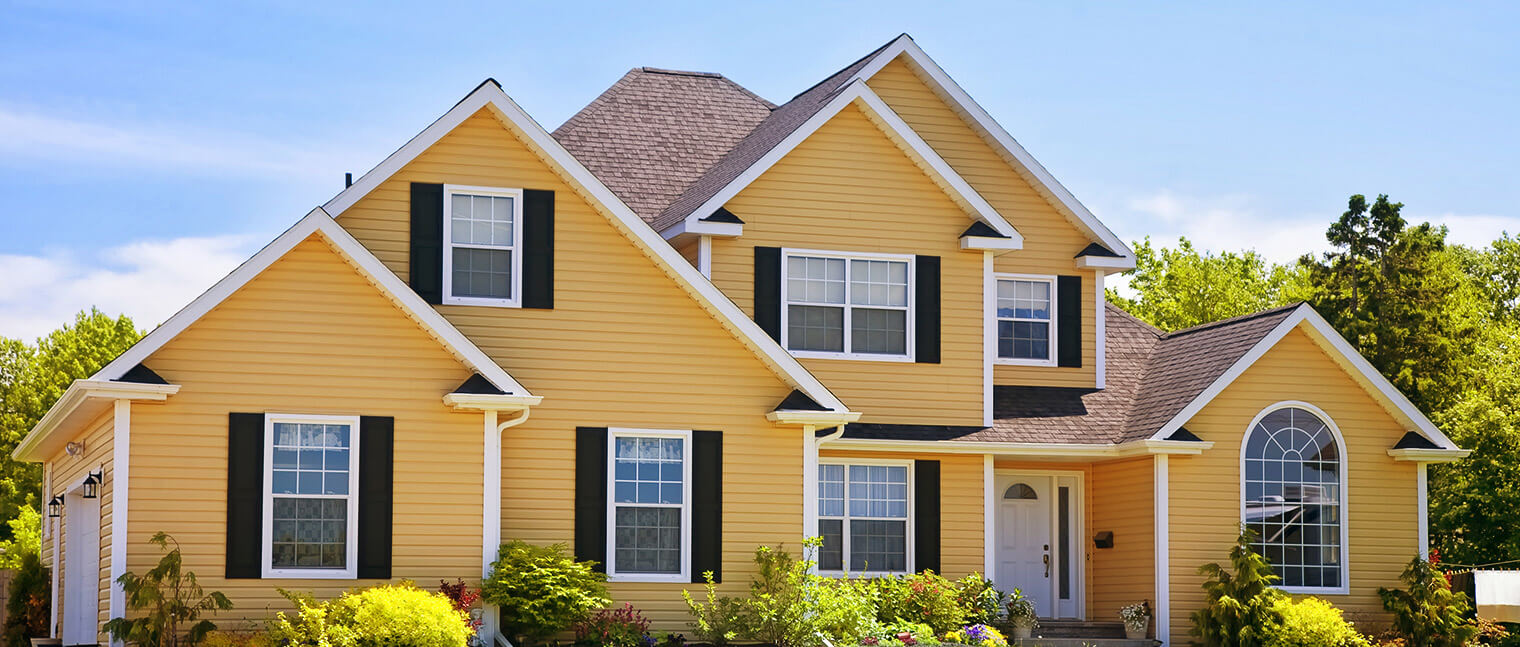 Gorgeous home with eco-friendly vinyl siding in a yellowish colour.