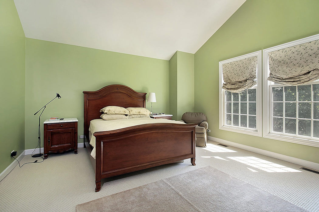 Green painted bedroom with two replacement double hung windows.