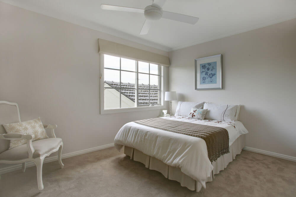 Simple bedroom with white bed and pvc double slider window.