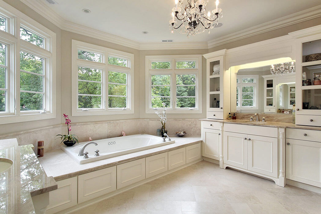 Modern bathroom with stylish bathtub and six casement windows with custom grilles.