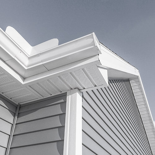 Image of a house with eavestrough, soffit and fascia in focus