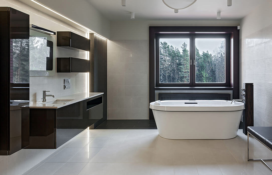 A modern bathroom with coordinated coloured windows, window trim, and bathroom finishes.