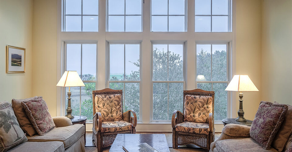 A living room with four large double-hung replacement windows.