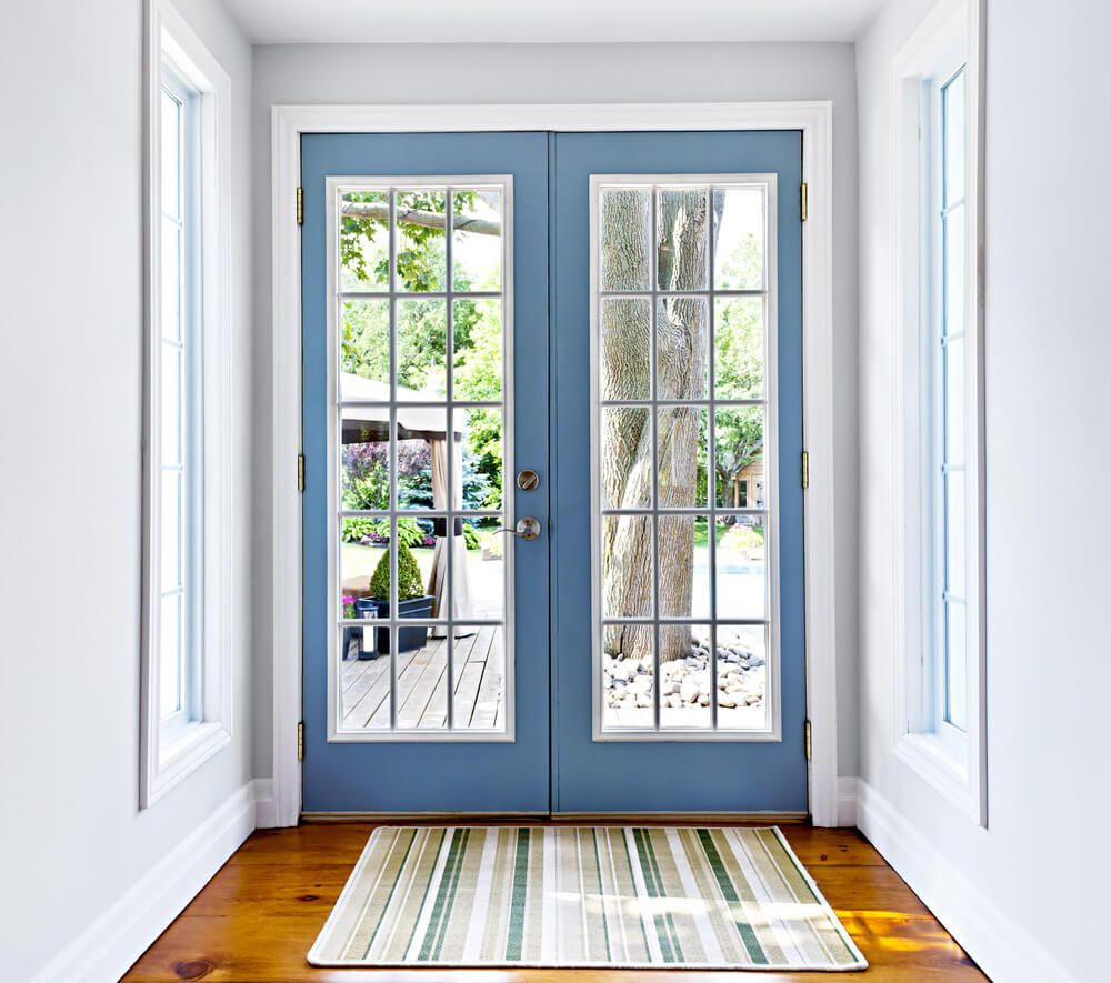 Modern, sky blue patio doors with square grilles.