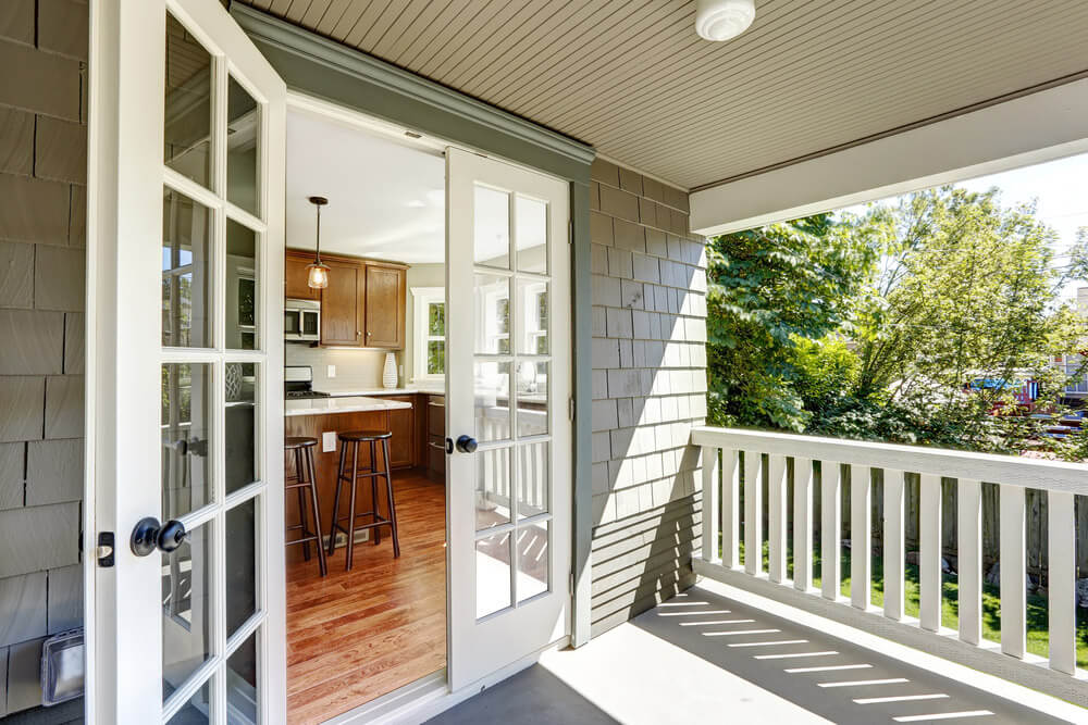 Patio Doors opening up from a kitchen to an enclosed deck.